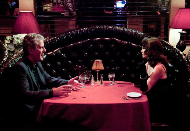Bourdain dining with Laura Shaffer at The Bootlegger.