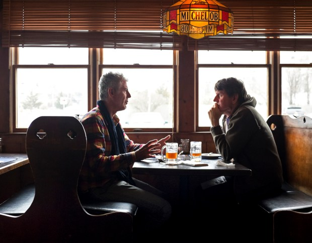 Bourdain with his brother, Christopher, at Kubel's.