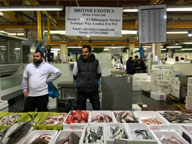 1. Salmon fillets at Billingsate Fish Market. / 2. Traders at Billingsgate Fish Market.