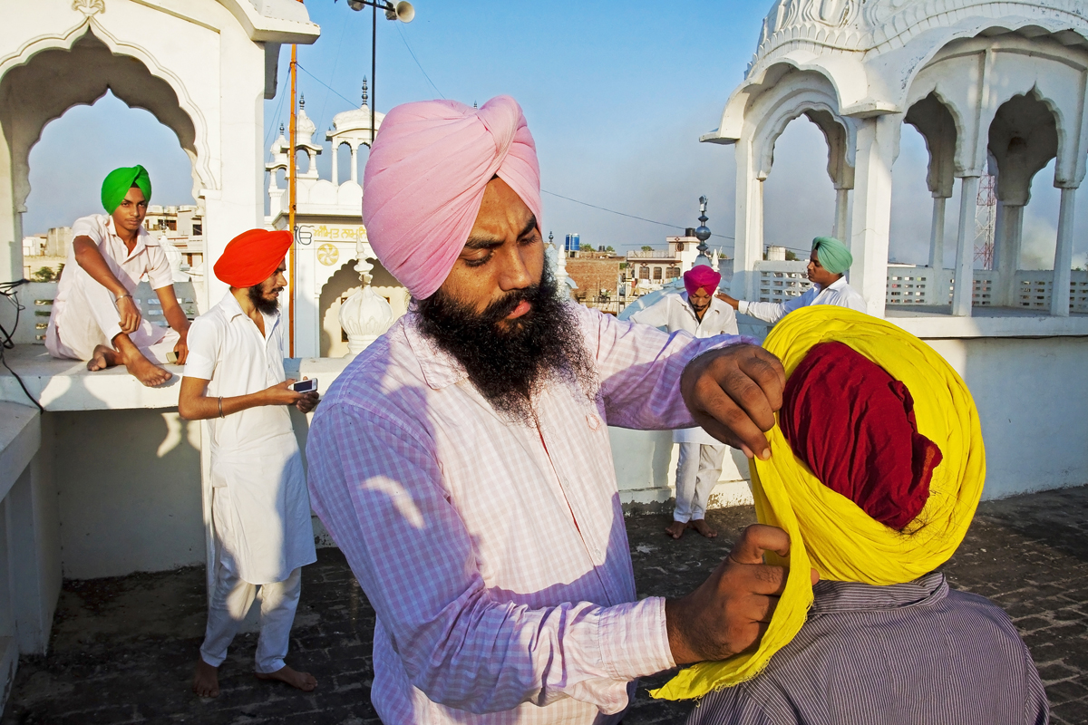 """""""The incident of a college friend's cutting of his hair and beard just because he could not tie a turban changed my life once and for all. Since then, we have held training camps in more than 500 rural villages of Punjab and distributed countless videos for self learning of turban tying."""""""