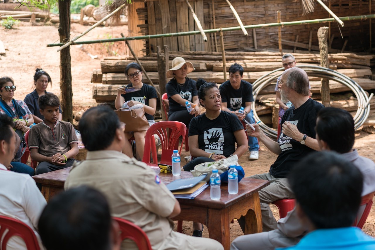 Channapha Khamvongsa with a delegation from Legacies of War during a visit to the village.