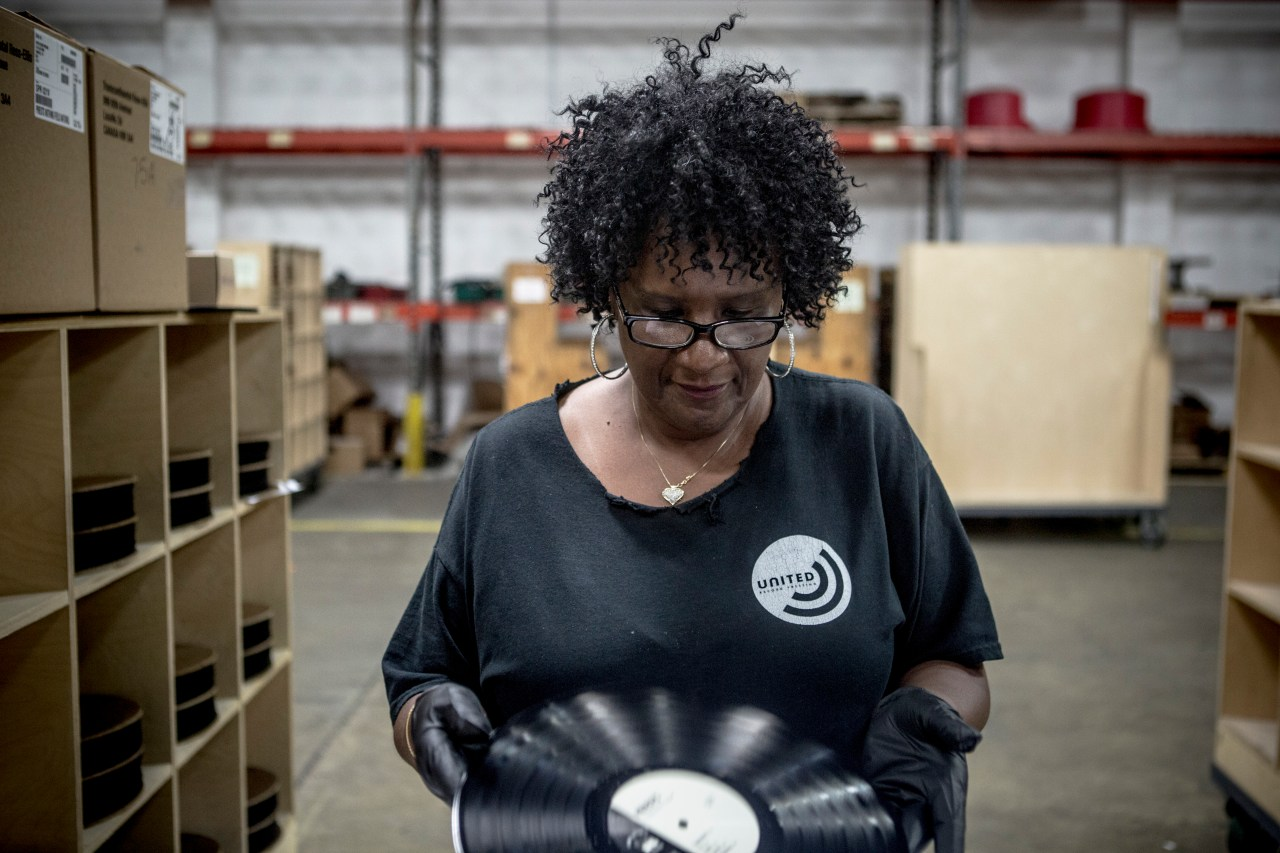 Janice Jones, an inspector, studies the vinyl before sliding it into its sleeve for packaging and shipping.