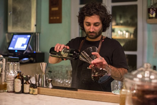 Wine writer Ziad Abi Akar opens a red wine that was made at The Couvent Rouge winery.