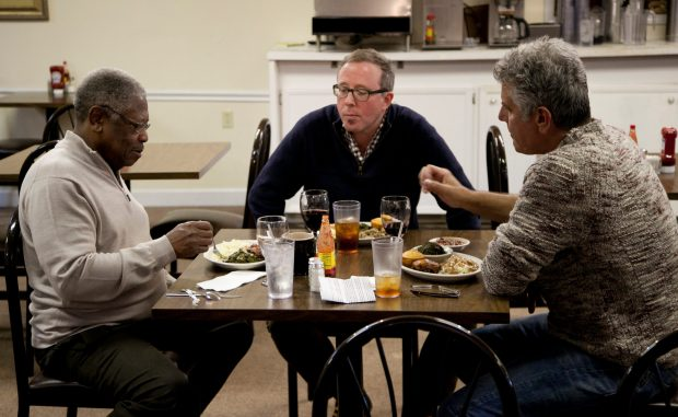 "Bourdain and John T. Edge (middle) join Senator Willie Simmons (left) for lunch at his restaurant, ""Senator's Place"" in Cleveland."
