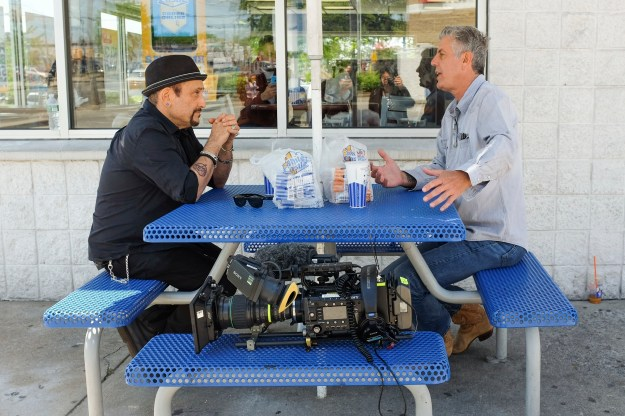 1: (L to R) Anthony Bourdain with Grandmaster Melle Mel. / 2: Handsome Dick Manitoba and Anthony Bourdain eating outside White Castle.