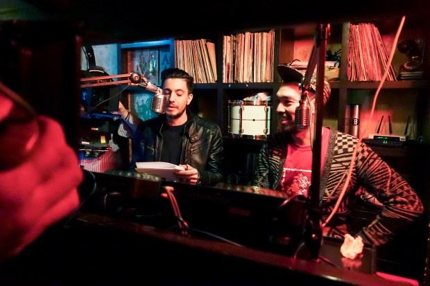 Chyno (right) in his studio.