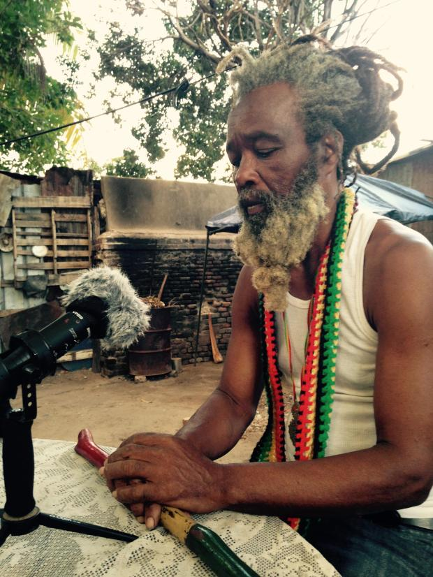Ras Ayatollah speaks with the writer in the yard at Ibo Spice in Downtown Kingston. (Photo by Saxon Baird)
