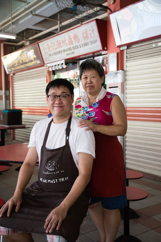 Melvin Chew and his mother pose outside of their stall.