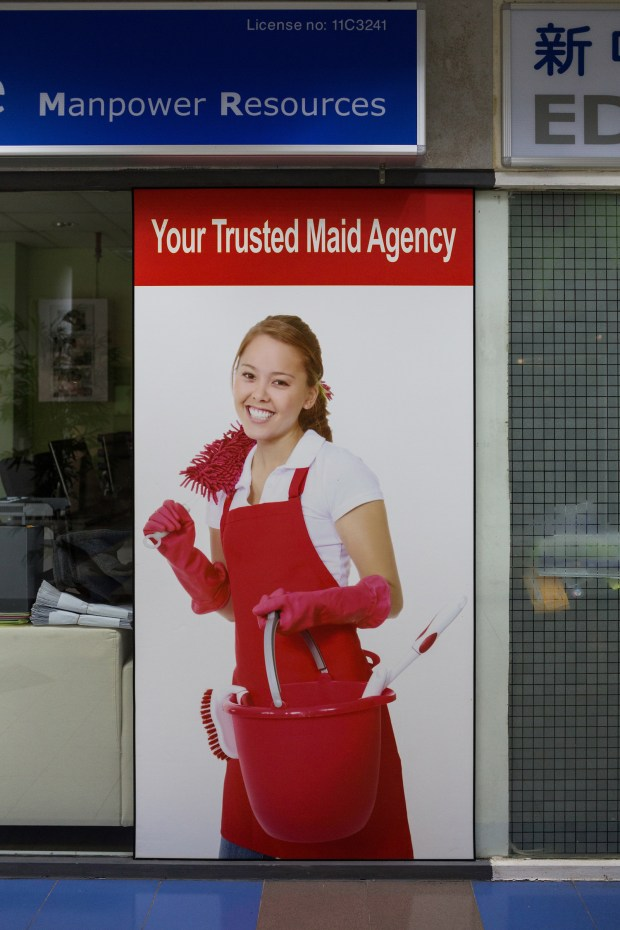 A maid agency advertises on their store front at Bukit Timah shopping centre in Singapore.