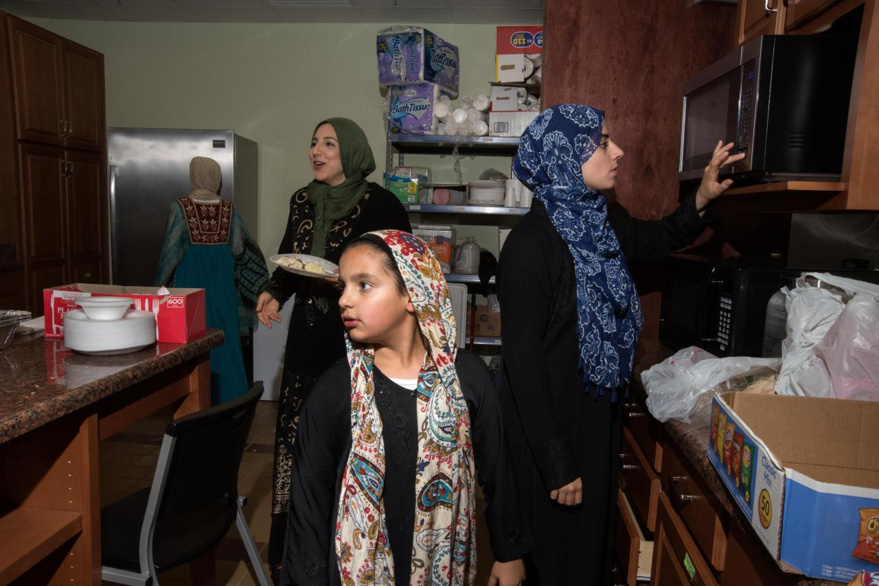 Food is served in the kitchen on an evening during Ramadan.