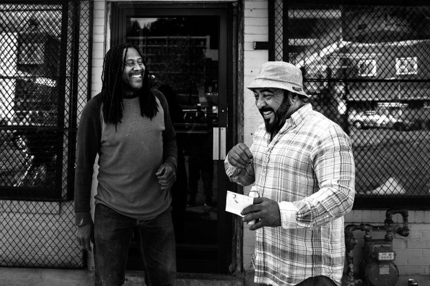 1. John Craven poses after receiving a haircut from Dave's Barber Shop. / 2. Rob Eberhart, a Northside native, shares a laugh with David Williams during his break. The two have been friends for most of their lives.