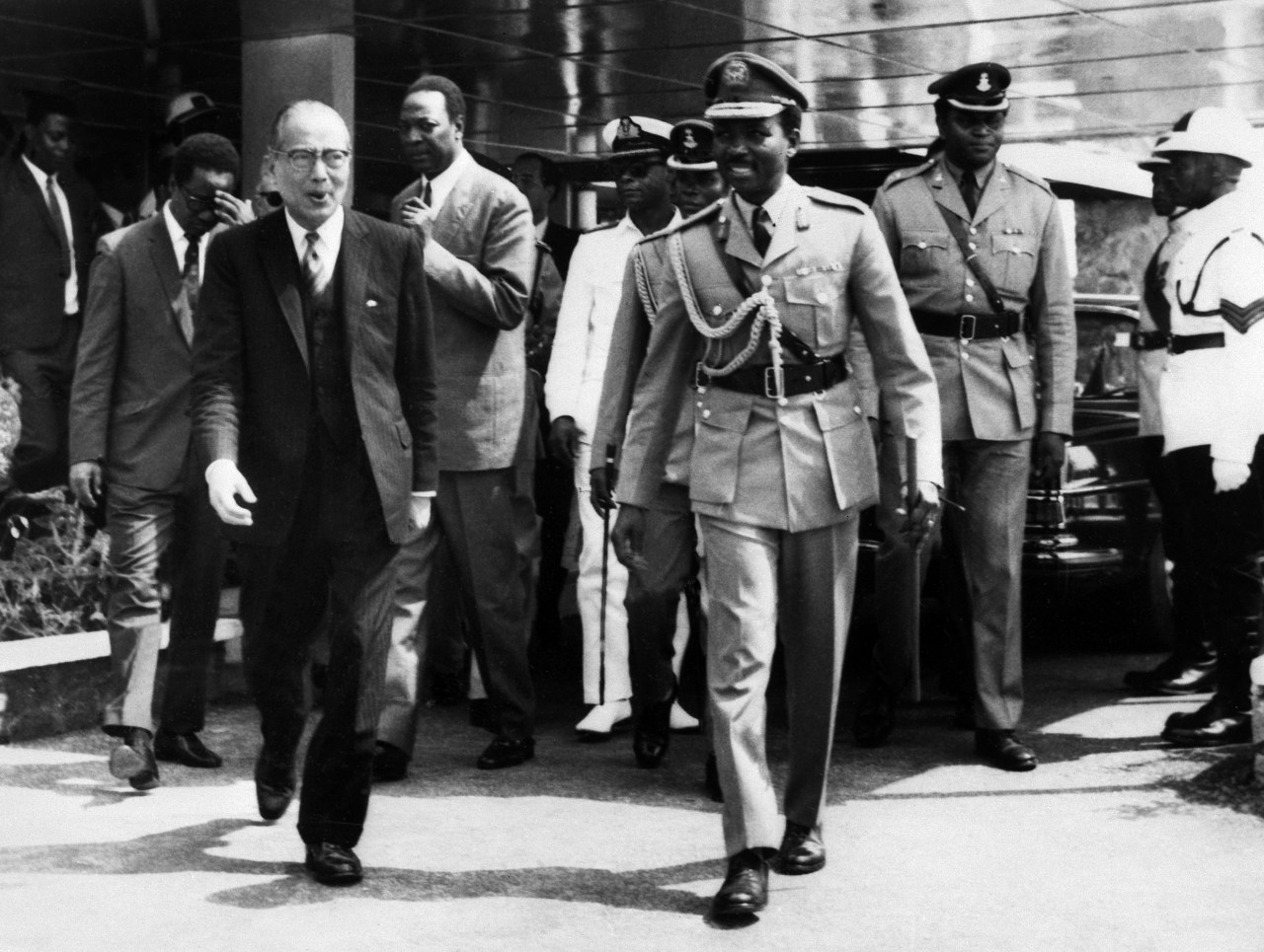 General Gowon (right) and visiting UN Secretary General U Thant (left) at Ikeja Airport on Jan. 19, 1970 during the Nigerian Civil War. (Photo by AFP via Getty Images)