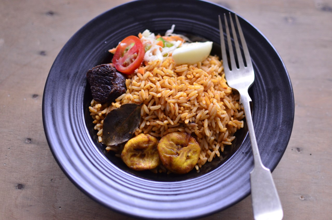 Your guide to nigerian cuisine explore parts unknown traditionally raw or parboiled long grain rice is cooked in a red tomato stew with meat or vegetable stock biocorpaavc Images