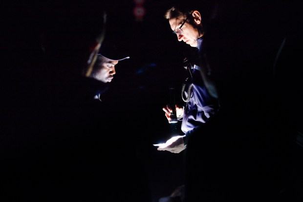 A policeman checks the identification papers of a migrant who was apprehended on the road to the Échelle mountain pass.