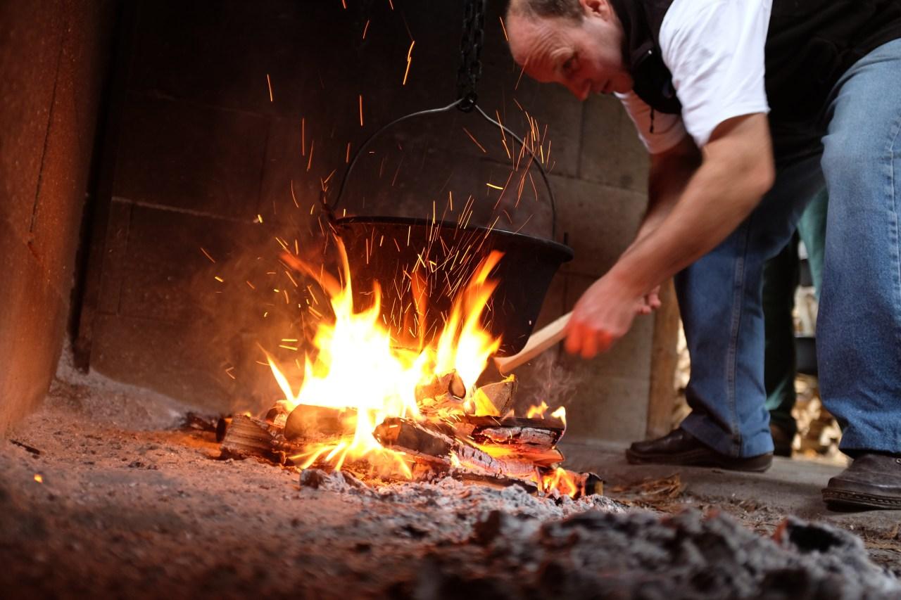 Halászlé is cooked on high flames, not coals. Rév Csárda's Feri Kocsis feeds the fire every few minutes.
