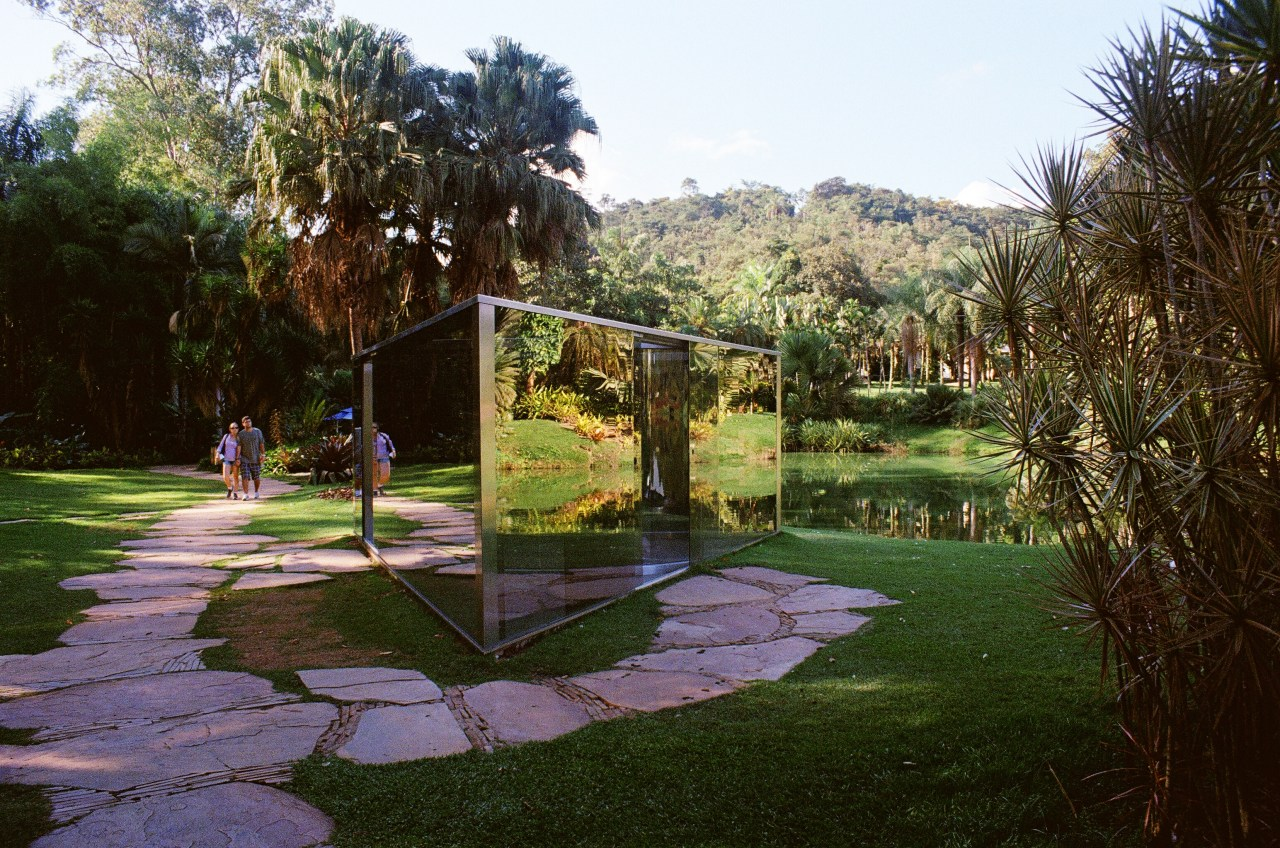 """Approaching Dan Graham's mirrored installation, """"Bisected Triangle, Interior Curve."""""""