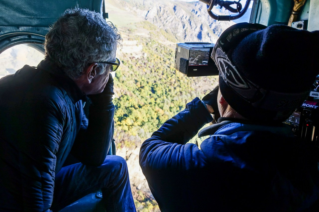 Director of Photography Zach Zamboni films Tony on a Soviet-era Mi8 Helicopter en route to Nagorno Karabakh.