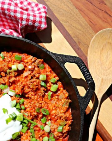 Easy low carb skillet breakfast with a wooden spoon and cutting board