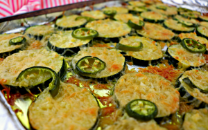 Easy low carb grilled garlic parmesan zucchini, the perfect summer Keto side dish. Picnics and get togethers, everyone will love this gluten-free recipe. #lowcarbsides #zucchini