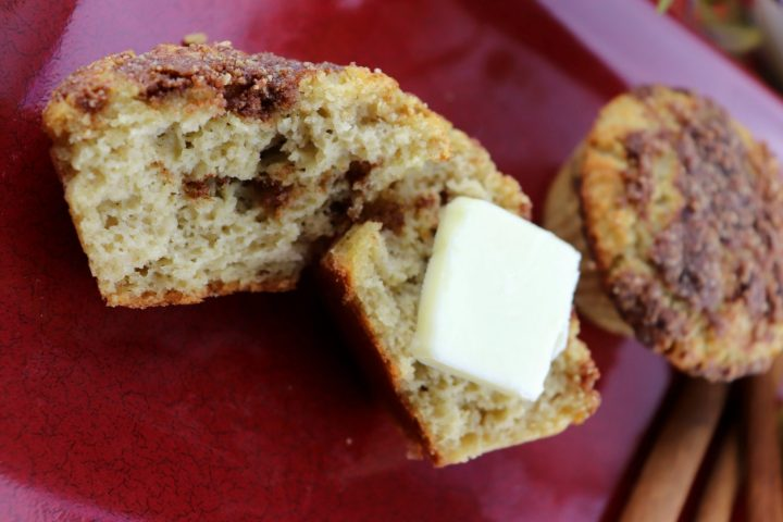 Open low carb coffee cake muffin with butter, closeup