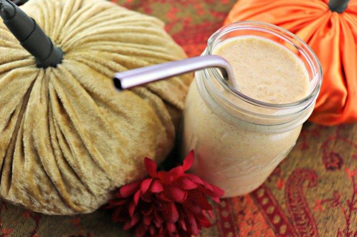 Keto pumpkin spice breakfast smoothie, straw close-up