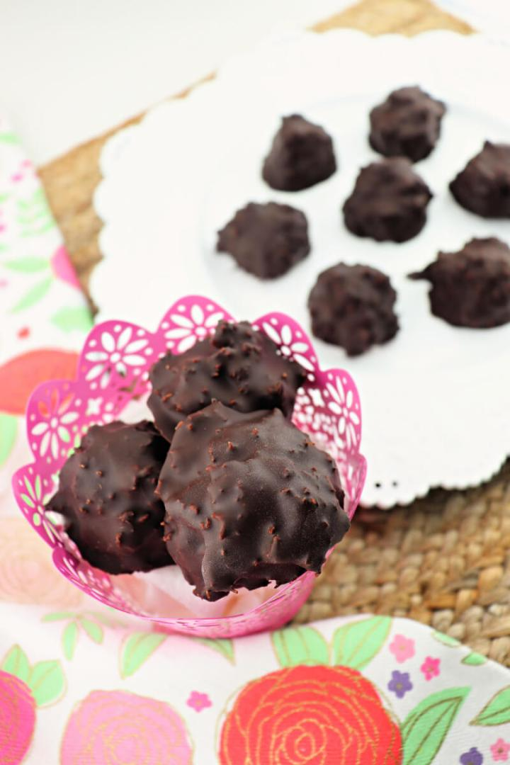 Delicious keto chocolate coconut balls are the perfect gluten-free sugar-free holiday candy to keep around during Easter, Christmas, or whenever you need a low carb alternative to candy! #ketocandy #lowcarbdessert