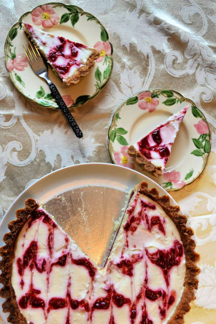 Pieces of keto Bakewell tart will be welcome at any low carb table! Delicious sugar-free raspberry jam and almond frangipane in an almond flour tart shell. #ketodessert #lowcarbtea