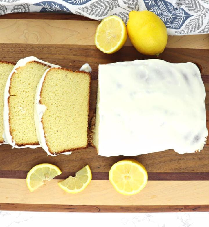 Delicious Keto lemon pound cake is sugar-free, gluten-free, and 9 grams of protein a slice! Enjoy for a low carb breakfast or dessert. #ketodessert #ketobreakfast