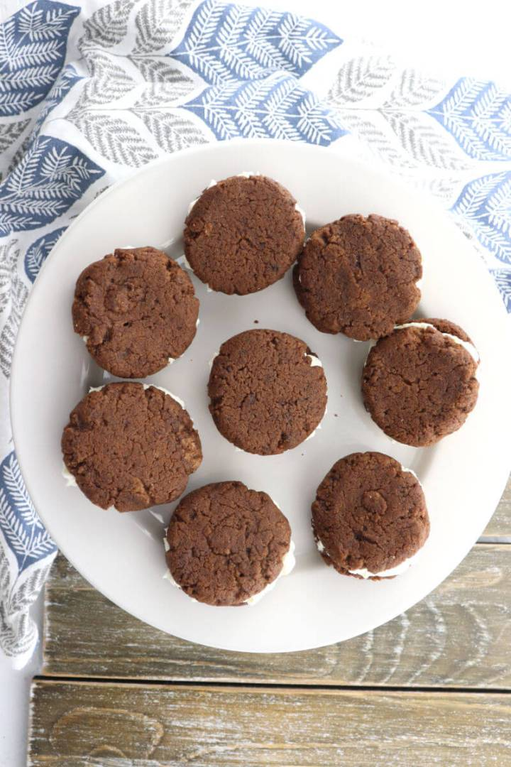 Soft and delicious keto chocolate sandwich cookies are a mix between keto oreos and keto whoopie pies. Gluten-free and sugar-free with a cream cheese filling, the result is perfect for a keto diet. #ketocookies #ketodesserts