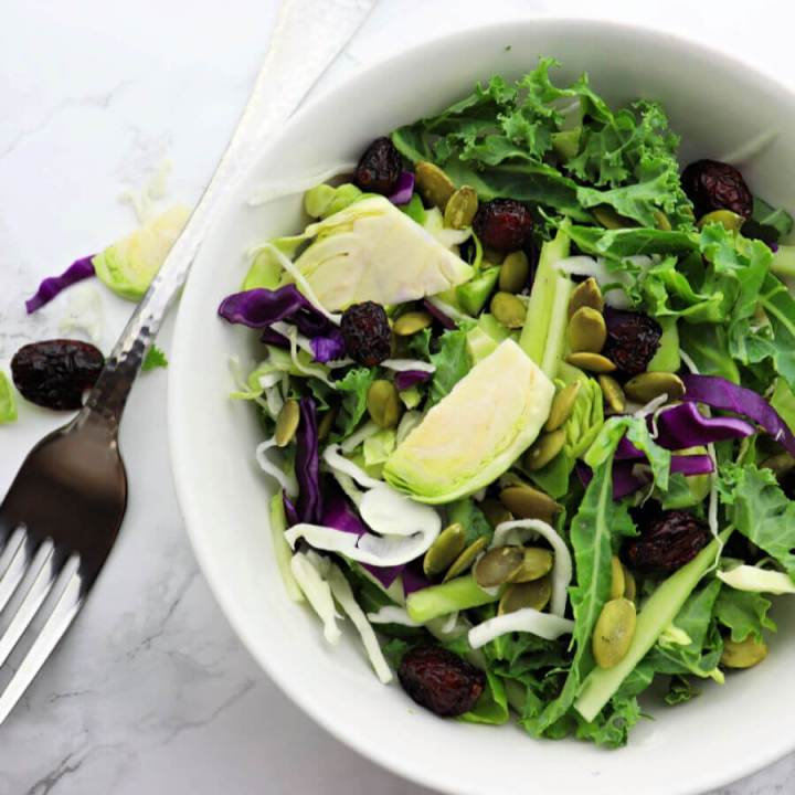 Kale crunch salad is filled with super-foods and a delicious healthy side for any holiday or event. Great for a low carb or keto diet, top with a sugar-free keto dressing and enjoy. #ketosalad #kalesalad
