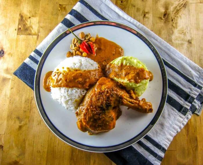 Congo Moambe Chicken served with rice and fufu