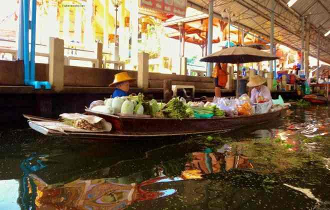 Selling vegetables along the Damnoen Saduak Floating Market