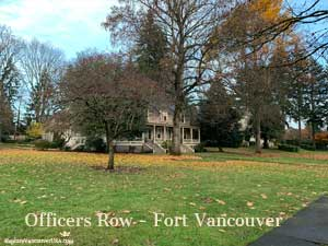 A variety of trees before and behind a home on Officers Row