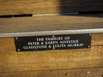 Plaques commemorating donors line the bottom of each stair.