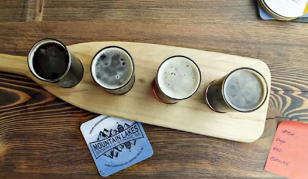 Spokane Beer Mountain Lakes Brewing Flight of beers on a paddle