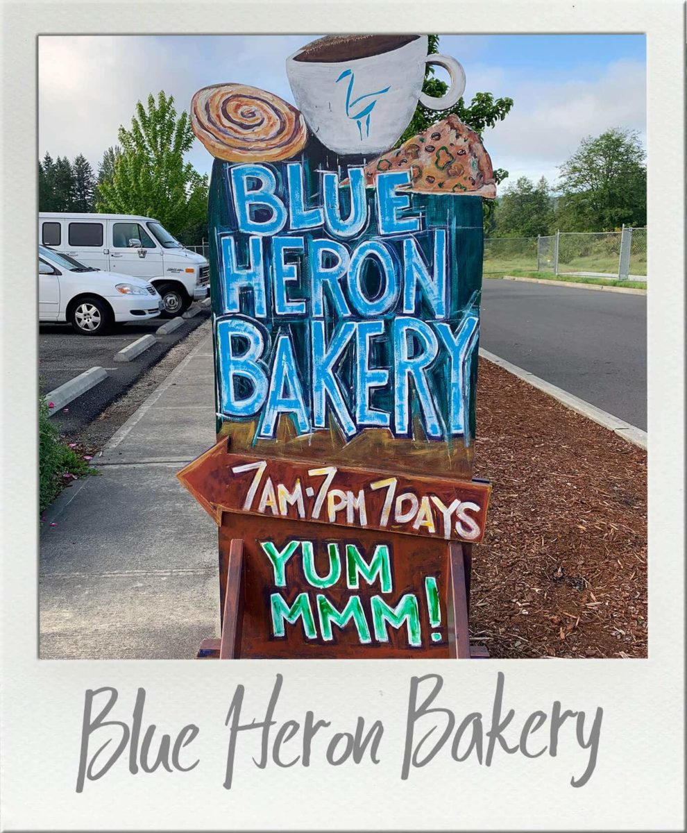 Blue Heron Bakery Olympia Hand Painted Sign in front of building