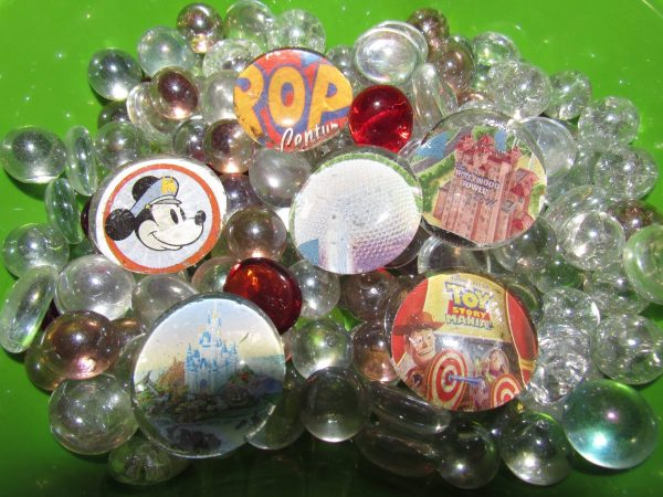 DIY Disney Parks Magnets sitting in a bowl of glass marbles