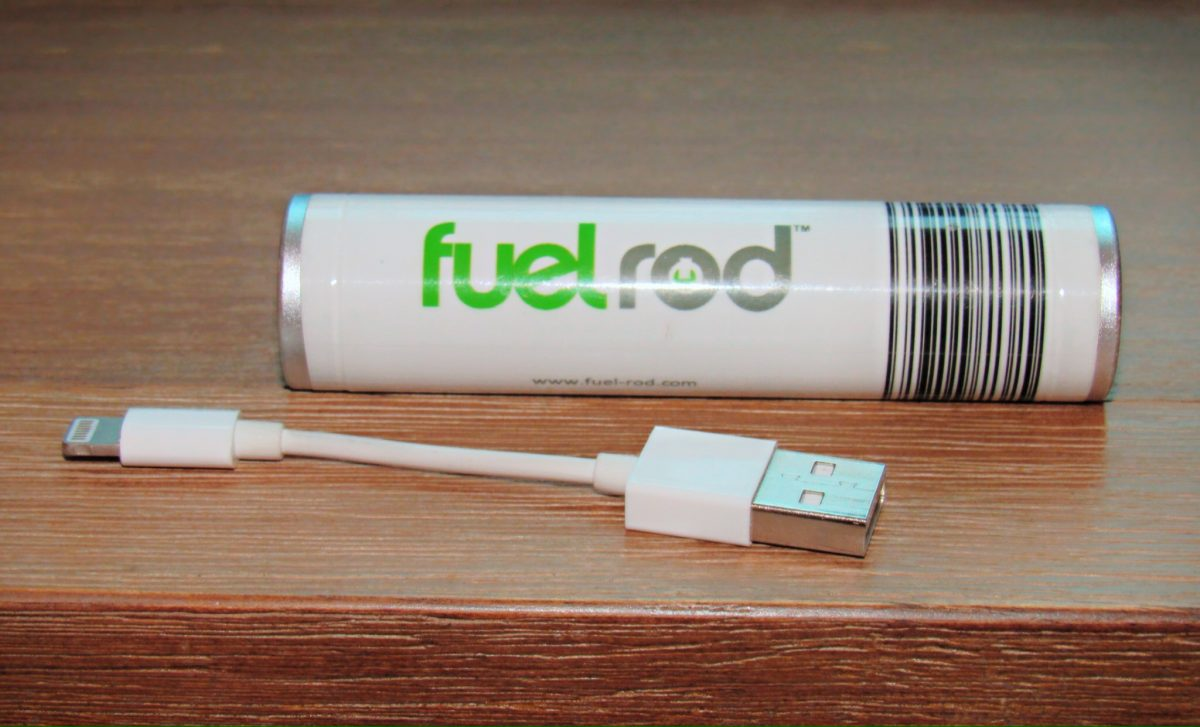 FuelRod battery and charger laying on a table
