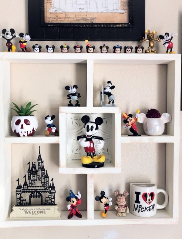 Display of Mickey Mouse figures hanging on a wall