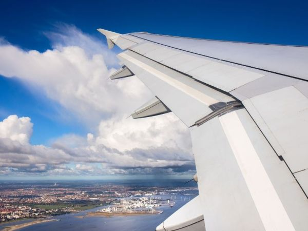 Wing of an airplane as it glides through the air
