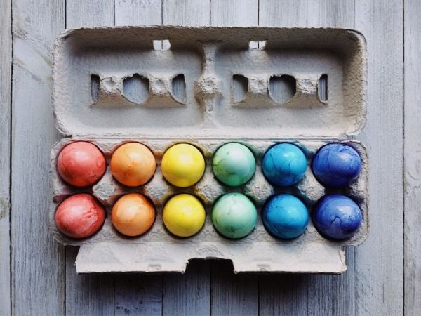 Colored Eggs sitting in a carton