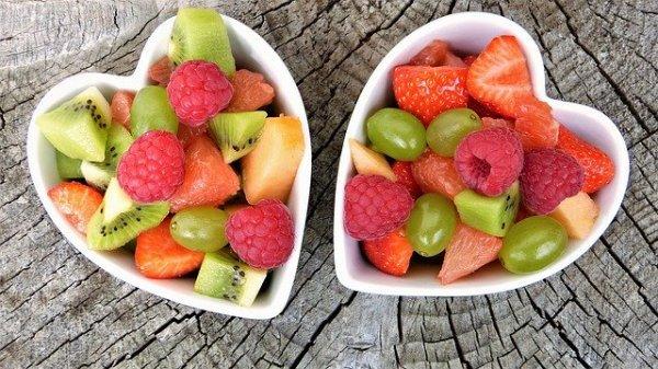 Fruit salad sitting in heart bowls