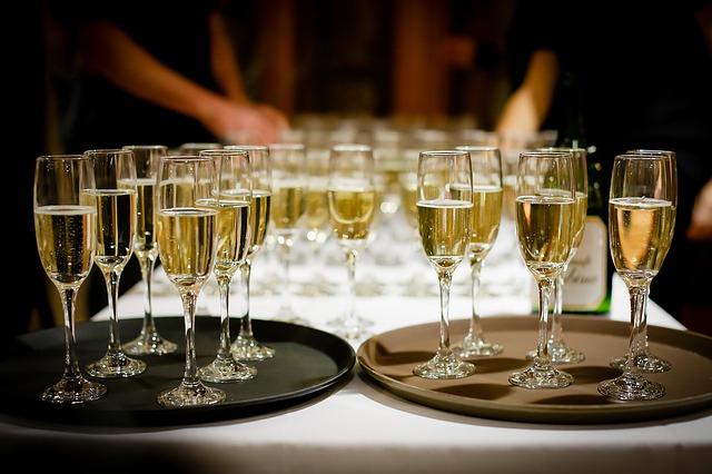 Glasses of wine sitting on trays