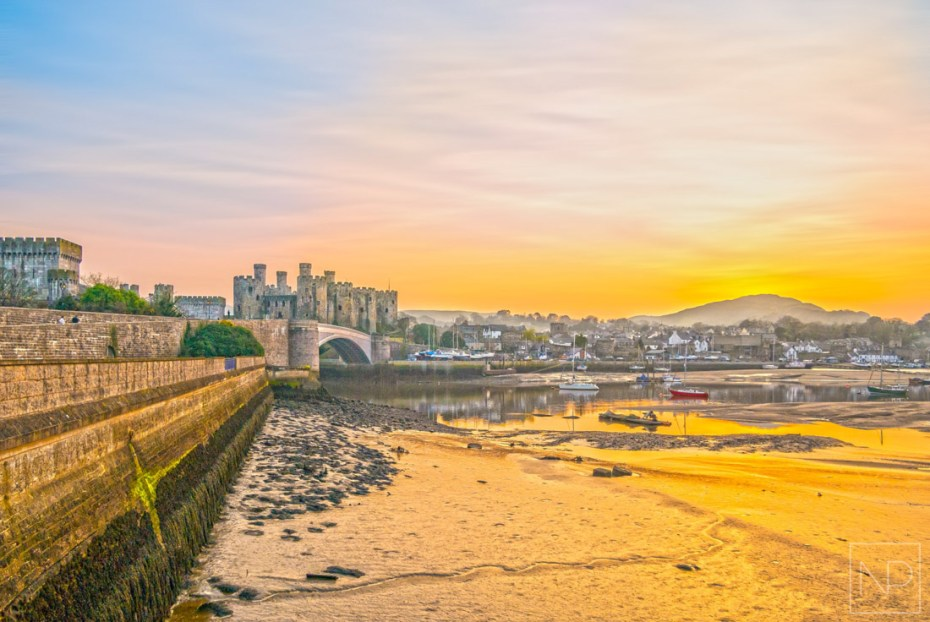 Conwy Castle and town in North Wales at sunset