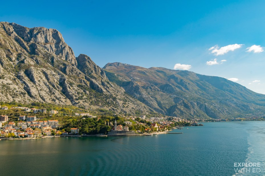 Dramatic limestone mountains rising above the Bay of Kotor and little towns