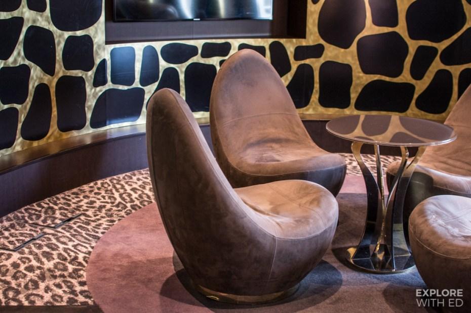 The Safari Lounge seating and animal print wallpaper and flooring