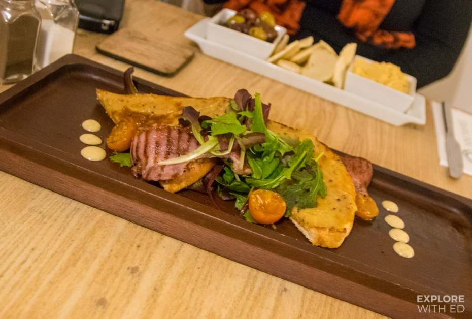 Welsh Rarebit with salad and crispy bacon