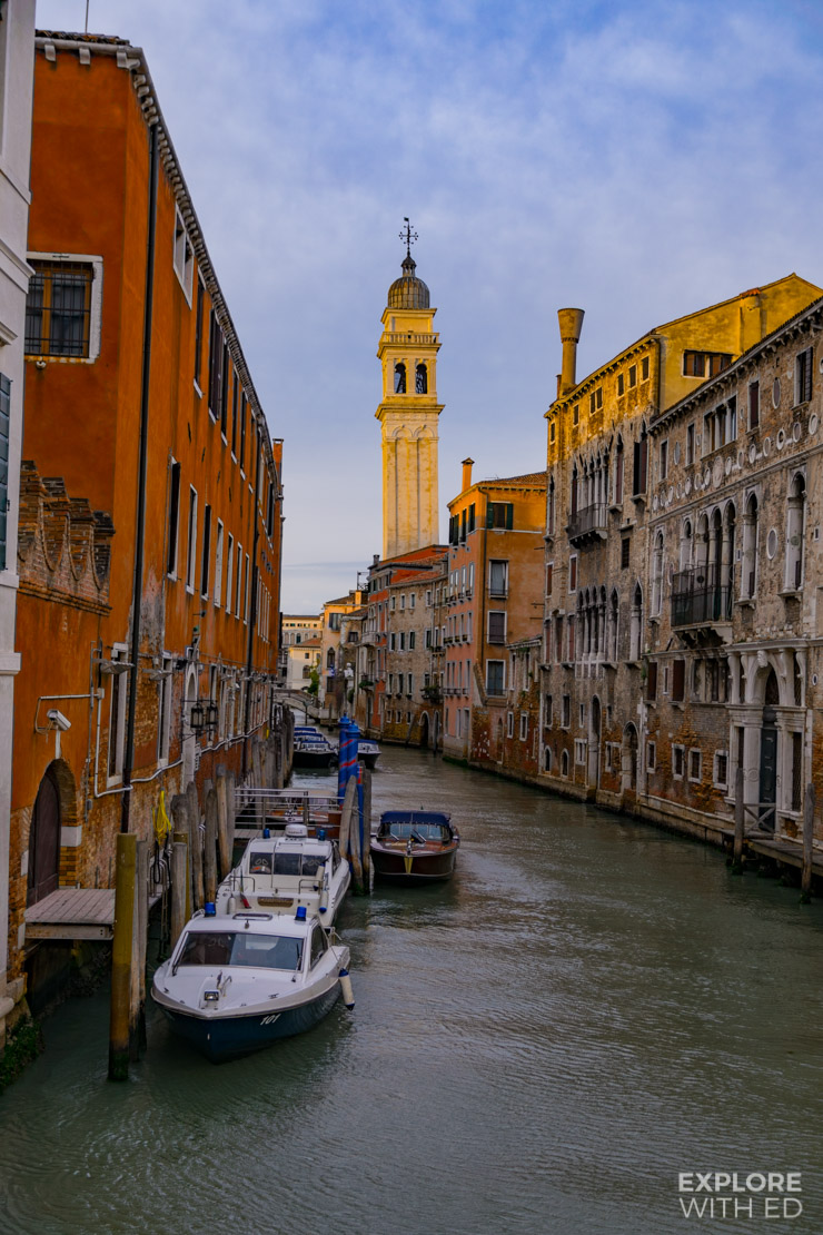 1 of the 170 canals of Venice lined with colourful buildings and historical churches