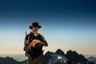 Matthew Lettington with Triple Peak in the background shot from Mount 5040