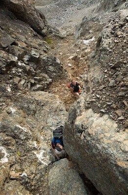 Phil and Phil scrambling down the tough section of the choss gully